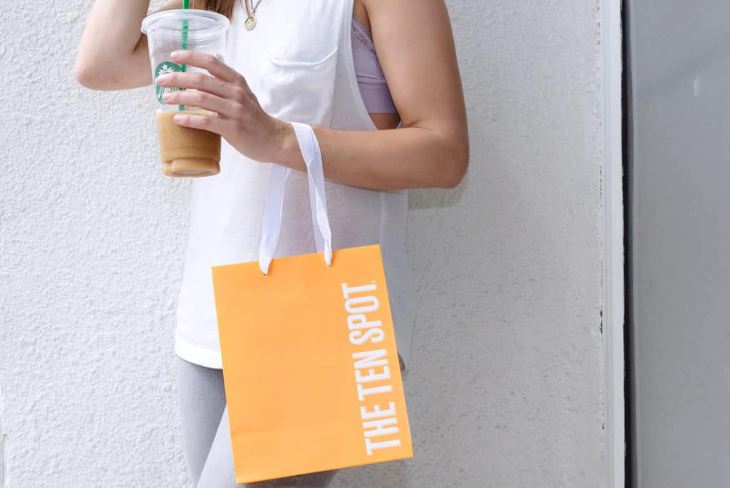 girl holding a bag from THE TEN SPOT® beauty bar in the annex